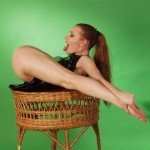 Flexible redhead in black leather outfit does mind-blowing nude gymnastics